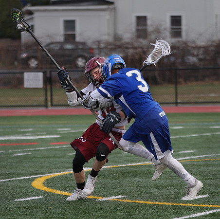MIKE SPRINGER/Staff photo<br /> Gloucester's Jacob Enos, left, and Brendan Tracey of Danvers collide during varsity lacrosse play Thursday in Gloucester.<br /> 4/19/2018