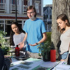 MIKE SPRINGER/Staff photo<br /> Members of the Rockport High School Green Team, from left, Amanda Verga, Nathaniel Kirby and Cat Rania, explain to a visitor the group's various activities during the Rockport Public Schools' First Night celebration Thursday evening in downtown Rockport. The event included performances and demonstrations of student projects in various school departments.<br /> 4/26/2018