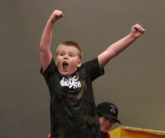 "MIKE SPRINGER/Staff photo<br /> Ten-year-old Jakob Lopes celebrates a victory during a ""Nerf Battle"" Monday at the Cape Ann YMCA. In the background is Jakob's teammate Winston Rich, 10.<br /> 4/16/2018"
