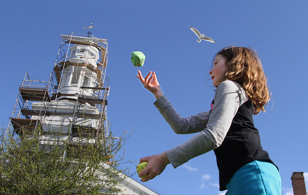 MIKE SPRINGER/Staff photo<br /> Maggie Olson, a third grader at Rockport Elementary School, demonstrates her juggling ability during the Rockport Public Schools' First Night celebration Thursday evening in downtown Rockport. The event included performances and demonstrations of student projects in various school departments.<br /> 4/26/2018