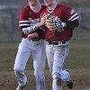 MIKE SPRINGER/Staff photo<br /> Gloucester second baseman Ben Oliver, left, congratulates shortstop Harry Marshall for catching a pop fly to end Everett's scoring drive in the fifth inning during varsity baseball action Wednesday in Gloucester.<br /> 4/11/2018