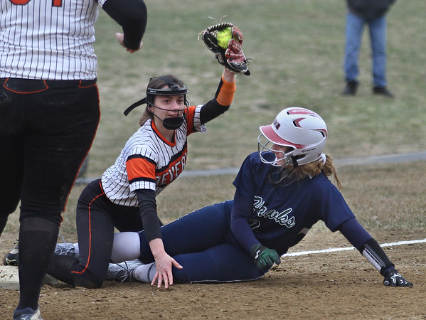 MIKE SPRINGER/Staff photo<br /> Beverly's Natalie Stilwell raises the ball after tagging out Hester Murphy of Essex Tech at third base during varsity softball action Saturday at Essex Tech.<br /> 4/14/2018