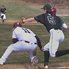 MIKE SPRINGER/Staff photo<br /> Jackson Levendusky of Manchester Essex tries to tag out Rockport's Noah Rawson between third base and home plate during varsity baseball action Saturday in Rockport. Rawson slipped away from Levendusky but was tagged out at home plate.<br /> 4/14/2018