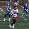 MIKE SPRINGER/Staff photo<br /> Gloucester's Dakota Girard prepares to pass the ball as Nate Sher, left, and Spenser Dougal of Danvers look on during varsity lacrosse play Thursday in Gloucester.<br /> 4/19/2018