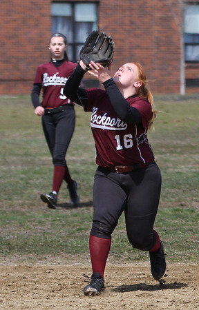MIKE SPRINGER/Staff photo<br /> Rockport shortstop Lauren Ryan prepares to catch a pop fly during varsity softball play Wednesday against Manchester Essex in Rockport.<br /> 4/18/2018