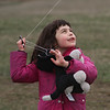 MIKE SPRINGER/Staff photo<br /> Six-year-old Sophia Widge of Somerville flies a kite Saturday during the annual Kite Day at Cogswell's Grant in Essex. The event drew a large crowd from across the region.<br /> 4/14/2018