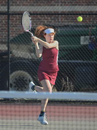 MIKE SPRINGER/Staff photo<br /> Gloucester's Christina Jones competes against a Saugus opponent during a varsity tennis match Monday in Gloucester.<br /> 4/23/2018