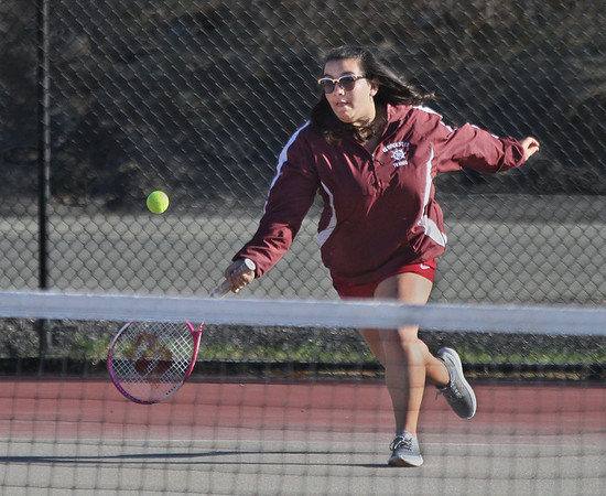 MIKE SPRINGER/Staff photo<br /> Gloucester's Carly Goulart competes in a doubles match against Saugus on Monday in Gloucester.<br /> 4/23/2018