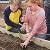 MIKE SPRINGER/Staff photo<br /> Fifth graders Braydon Wall and Madison Slier plant lettuce seeds Wednesday at Rockport Elementary School. Students throughout the school planted seeds. They will harvest the various varieties of lettuce in May and eat them in salads in the school cafeteria.<br /> 4/11/2018