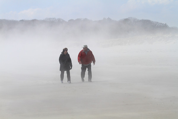 MIKE SPRINGER/Staff photo<br /> Debbie and Donnie Laurie of Gloucester walk through the fog Wednesday on Good Harbor Beach in Gloucester.<br /> 4/11/2018