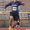 MIKE SPRINGER/Staff photo<br /> Edgard Dossantos of Peabody competes in the triple jump Tuesday in Gloucester.<br /> 4/10/2018