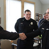 MIKE SPRINGER/Staff photo<br /> Tom Delaney, left, shakes hands with officer Keith Militello, right, as officer Michael Foote looks on Thursday during a public reception at police headquarters for Militello and Foote, both recent police academy graduates who are new to the Rockport Police Department.<br /> 4/26/2018