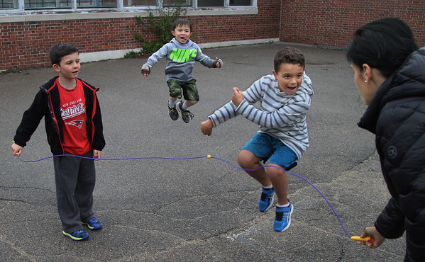 MIKE SPRINGER/Staff photo<br /> Supervisor Amy Coleman plays jump rope with kindergartners, from left, Danny Oliver, Makani Mitchell and Nathan Frangioso during the Manchester Parks & Recreation Department's Kindergarten Busy Bees after-school program Wednesday at Manchester Memorial School.<br /> 4/25/2018