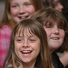 MIKE SPRINGER/Staff photo<br /> Third-grader Alexis Geary and classmates enjoy a presentation Friday on electromagnetism at Plum Cove School.<br /> 4/13/2018