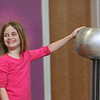 MIKE SPRINGER/Staff photo<br /> Fourth-grader KacKenzie Orleans laughs as her hair stands on end due to a buildup of static electricity after she placed her hand on a Van de Graaff generator during a presentation on electromagnetism by the Museum of Science on Friday at Plum Cove Elementary School in Gloucester.<br /> 4/13/2018