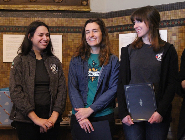 MIKE SPRINGER/Staff photo<br /> From left, TerraCorps service member Mackenzie Sains, FoodCorps service member Samantha Drown, and TerraCorps service member Sarah Visnick, all currently serving with the Gloucester-based Backyard Growers, are honored Tuesday during the 6th annual National Service Recognition Day ceremony at Gloucester City Hall.<br /> 4/3/2018