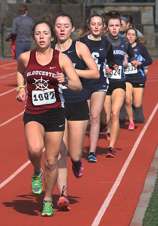 MIKE SPRINGER/Staff photo<br /> Gloucester's Holly Fossa leads the field on her way to victory in the two-mile run Tuesday against Peabody at Gloucester.<br /> 4/10/2018