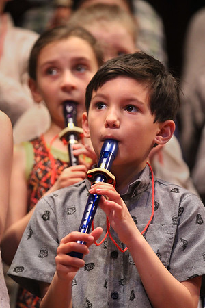 "MIKE SPRINGER/Staff photo<br /> Third-grader Jack Frontiero plays the recorder during a Rockport Elementary third grade concert Tuesday at the Shalin Liu Performance Center. In the background is Jack's classmate Savannah Ryan. The students, under the direction of music teacher Kaitlin Shaw-Reese, entertained their families with music ranging from Beethoven's ""Ode to Joy"" to a tune called ""Alfred the Alligator.""<br /> 4/3/2018"
