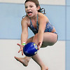 MIKE SPRINGER/Staff photo<br /> Eight-year-old Kayleigh Thurman of Gloucester catches a football in mid-air after jumping off the diving board Monday at the Cape Ann YMCA swimming pool in Gloucester. The YMCA is busy this week with special events for school vacation week.<br /> 4/16/2018