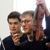 MIKE SPRINGER/Staff photo<br /> Violinists Sylvain Favre-Bulle, right, and Nicolas Van Kuijk, members of the Paris-based Van Kujk Quartet, speak to students during a Rockport Music-sponsored performance Wednesday at Veterans Memorial Elementary School in Gloucester. The musicians performed music by Debussy, Ravel and other composers, and explained the role each instrument plays in the quartet. The cellist, Francois Robin, played an instrument made in Milan in 1540 -- one of the oldest known cellos in the world. The internationally known quartet, based in Paris, will perform at 7 p.m. Thursday at the Shalin Liu Performance Center in Rockport.<br /> 4/11/2018