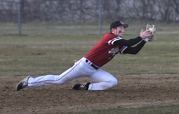 MIKE SPRINGER/Staff photo<br /> Gloucester shortstop Harry Marshall catches a fly ball to end the fifth inning during varsity baseball action Wednesday against Everett in Gloucester.<br /> 4/11/2018