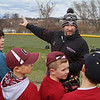 MIKE SPRINGER/Staff photo<br /> Gloucester High School varsity baseball coach Bryan Lafata talks to a group of young players Tuesday during the Future Fishermen Little League Clinic in Gloucester. Sixty-five to 70 kids participated in the annual event, which was led by members of the GHS varsity baseball team.<br /> 04/17/2018