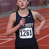 MIKE SPRINGER/Staff photo<br /> Peabody's Lilly Brennan competes in the two-mile run Tuesday in Gloucester.<br /> 4/10/2018