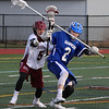 MIKE SPRINGER/Staff photo<br /> Gloucester's Dakota Girard, left, and Spenser Dougal of Danvers compete for the ball during varsity lacrosse play Thursday in Gloucester.<br /> 4/19/2018