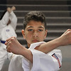MIKE SPRINGER/Staff photo<br /> Twelve-year-old Ryan DeSouza of Gloucester works out at Demetri's Taekwondo Academy in Gloucester. A sixth grader at O'Maley Middle School, Ryan recently won two first place titles at the New England Masters championship in Canton, adding to a growing list of medals and trophies. He received a sad setback last week when his coach, Phil Demitri, died, but he continues to practice under the leadership of Demitri's assistant, Brie-ann Martell.