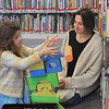 MIKE SPRINGER/Staff photo<br /> Christina Ginsburg watches as her daughter Lilly, 5, plays with blocks in the children's room of the Rockport Public Library.