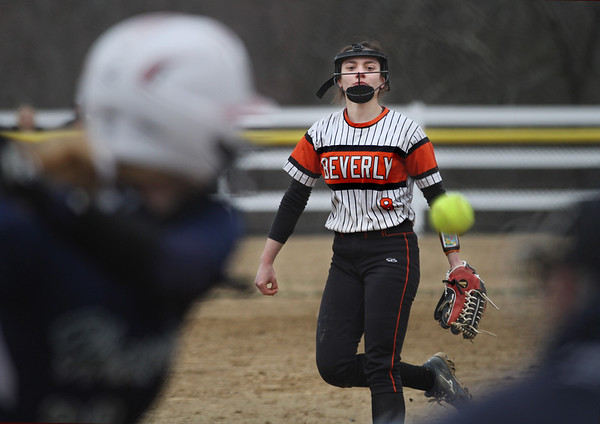 MIKE SPRINGER/Staff photo<br /> Beverly's Natalie Stilwell pitches against an Essex Tech batter during varsity softball action Saturday at Essex Tech.<br /> 4/14/2018