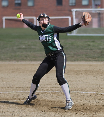 MIKE SPRINGER/Staff photo<br /> Sydney Levasseur pitches for Manchester Essex in varsity softball play Wednesday in Rockport.<br /> 4/18/2018