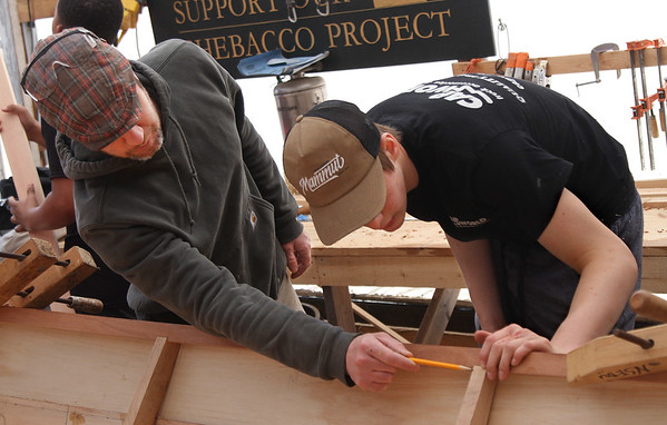 MIKE SPRINGER/Staff photo<br /> Boat builder Jeff Lane of the Essex Shipbuilding Museum instructs Matt Moran of Danvers, a junior at the Topsfield Vocational Academy, on how to fair the frame of a 20-foot Banks dory Thursday in Essex.<br /> 4/12/2018