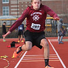 MIKE SPRINGER/Staff photo<br /> Gloucester's Chris MacDonald competes in the triple jump Tuesday against Peabody at Gloucester.<br /> 4/10/2018