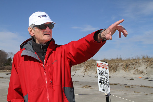 MIKE SPRINGER/Staff photo<br /> Ken Whittaker, conservation agent for the city of Gloucester, investigates the piping plover nesting site Wednesday morning on Good Harbor Beach in Gloucester.<br /> 4/18/2018