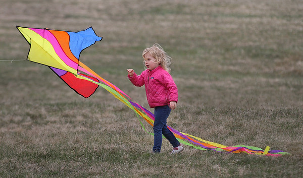MIKE SPRINGER/Staff photo<br /> Four-year-old Zephyr Lilley of Hamilton launches a kite Saturday during the annual Kite Day at Cogswell's Grant in Essex. Fittingly for the occasion, Zephyr's first name means a gentle breeze.<br /> 4/14/2018