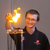 MIKE SPRINGER/Staff photo<br /> Brendan Cole of the Museum of Science ignites a piece of paper to demonstrate how some of the energy from a static electricity charge can be converted into heat energy Friday at Plum Cove Elementary School.<br /> 4/13/2018
