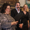 MIKE SPRINGER/Staff photo<br /> Gloucester Mayor Sefatia Romeo Theken, left, reads a proclamation honoring the many volunteers who help keep the various SeniorCare programs running as SeniorCare CEO Scott Trenti and Ruth Lindsey, director of SeniorCare's RSVP program, looks on Tuesday during the 6th annual National Service Recognition Day ceremony at Gloucester City Hall.<br /> 4/3/2018