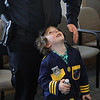 MIKE SPRINGER/Staff photo<br /> Five-year-old Jameson Militello, wearing his own police uniform, looks up to his father, Rockport police officer Keith Militello, during a public reception at police headquarters Thursday for new officers Militello and Michael Foote.<br /> 4/26/2018