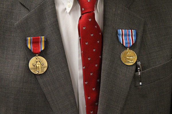 MIKE SPRINGER/Staff photo<br /> Robert Henry Leet wears the World War II Victory Medal, left, and the American Campaign Medal following a ceremony in his honor Friday at U.S. Coast Guard Station Gloucester.<br /> 4/20/2018