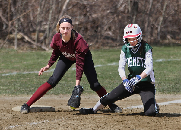 MIKE SPRINGER/Staff photo<br /> Kristen Harding, left, of Manchester Essex slides safely into third base as third baseman Elizabeth Higgins of Rockport applies the tag too late during varsity softball play Wednesday in Rockport.<br /> 4/18/2018