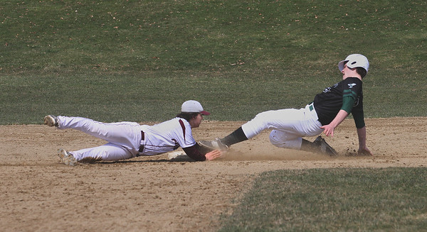 MIKE SPRINGER/Staff photo<br /> Rockport's Kyle Beal tags out number 9 of Manchester Essex during varsity baseball action Saturday in Rockport.<br /> 4/14/2018