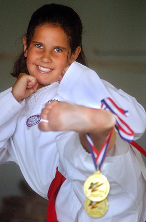 Gloucester: <br /> Gloucester's Andie-Jane Phinney, 9, won two gold medals at the U.S. Taekwondo Junior Olympics in forms and sparring recently. She also won a gold and silver last year.<br /> Photo by Mike Dean/Gloucester Daily Times. Monday, July 12, 2004