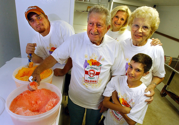 "Gloucester: The family of Joe Ciaramitaro, center, otherwise known as ""Joe Popcorn,"" has started up the family business again after about twenty years of retirement for Joe. From left is Joe's grandson, Anthony Curcuru, Joe, daughter Gina Ciaramitaro, wife Rose Ciaramitaro, and grandson Zachary Ciaramitaro, 11. (Photo by Mike Dean/Gloucester Daily Times). Monday, July 28, 2003 (NOTE: THIS IS A DIGITAL CAMERA IMAGE).<br /> **************************************<br /> Filter: Min (QMPro: Red Radius:0/Blue Radius:3/No Desp.)<br /> USM: Normal (Amt:200/Radius:0.3/Thresh:2)<br /> File Size: 8.03MB<br /> Original file name: DSC_2150.JPG"