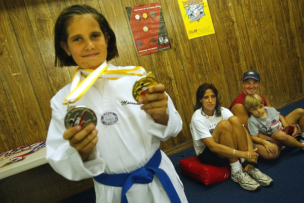 Gloucester: Andie-Jane Phinney shows her gold and silver medal from the taekwondo olympics ((((((check this with Dom))). At right is her...... (Photo by Mike Dean/Gloucester Daily Times). Friday, July 11, 2003 (NOTE: THIS IS A DIGITAL CAMERA IMAGE).<br /> **************************************<br /> Filter: Min (QMPro: Red Radius:3/Blue Radius:9/Desp.)<br /> USM: Strong (Amt:300/Radius:0.3/Thresh:2)<br /> File Size: 7.65MB<br /> Original file name: DSC_1051.JPG