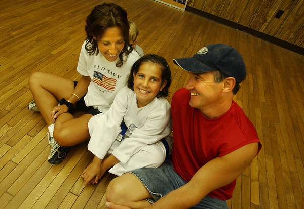 Gloucester: Taekwondo champion Andie-Jane Phinney sits on the floor of the dojo??? with her parents.... (Photo by Mike Dean/Gloucester Daily Times). Friday, July 11, 2003 (NOTE: THIS IS A DIGITAL CAMERA IMAGE).<br /> **************************************<br /> Filter: Min (QMPro: Red Radius:0/Blue Radius:6/Desp.)<br /> USM: Normal (Amt:200/Radius:0.3/Thresh:2)<br /> File Size: 7.87MB<br /> Original file name: DSC_1002.JPG