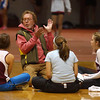 Gloucester: Boys coach Jim Munn gives some pointers to the girls high jumping team during their meet against Lynn Classical and Winthrop. Photo by Deborah Hammond/Gloucester Daily Times Saturday, December 09, 2006