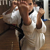 Gloucester: Andie Jane Phinney, 12, from Gloucester, practices some kicks during class at DeMetri's Taekwondo Studio Tuesday night. Phinney just received her black belt status and has won several gold medals in tournaments. Photo by Deborah Hammond/Gloucester Daily Times Tuesday, December 05, 2006