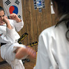 Gloucester: Andie Jane Phinney, 12, practices some line spars with Amber Sears, 14, both from Gloucester, during class at DeMetri's Taekwondo Studio Tuesday night. Phinney just received her black belt status and has won several gold medals in tournaments. Photo by Deborah Hammond/Gloucester Daily Times Tuesday, December 05, 2006