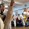 Gloucester: Andie Jane Phinney practices some kicks during class at DeMetri's Taekwondo Studio Tuesday night. Phinney just received her black belt status and has won several gold medals in tournaments. Photo by Deborah Hammond/Gloucester Daily Times Tuesday, December 05, 2006